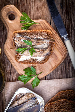 sprats: Sandwich with sprats with parsley and lemon.