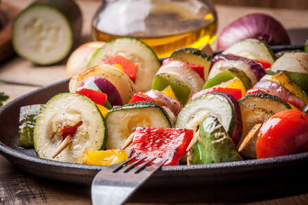 cast iron pan: Vegetable skewers on a cast iron skillet.