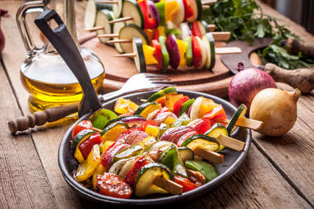 cast iron: Vegetable skewers on a cast iron skillet.