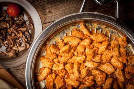 breast pocket: Pieces of fried chicken with spices in a pan. Selective focus. Stock Photo