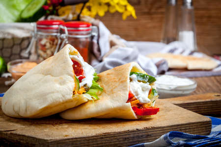 tzaziki: Fried chicken meat with vegetables in pita bread. Selective focus.
