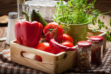 herbs boxes: Vegetables from the home garden in a wooden box. Stock Photo