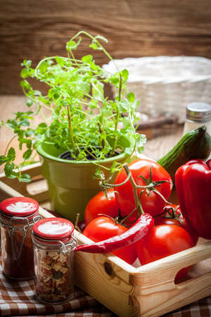 Vegetables from the home garden in a wooden box. Stock Photo