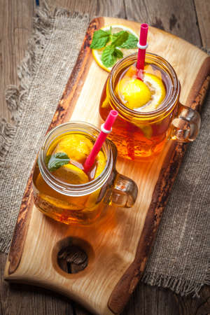 Fresh homemade ice tea with lemon and mint.