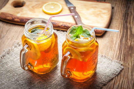 Fresh homemade ice tea with lemon and mint.