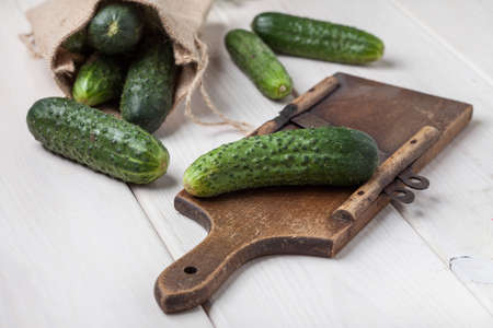 Raw cucumbers on cutting board. Selective focus.