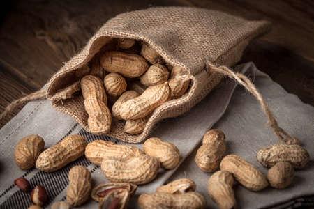 Peanuts in a burlap bag. Selective focus.