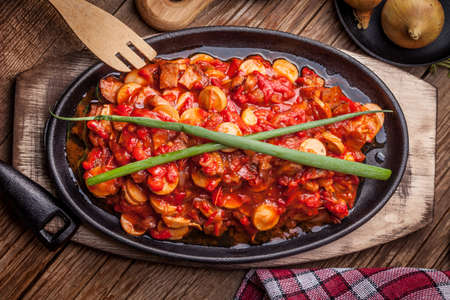 cast iron pan: Lecho - Delicious Hungarian dish in cast iron pan.