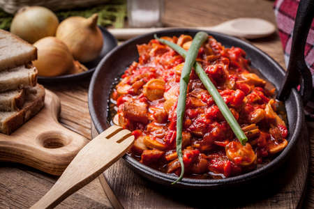 Lecho - Delicious Hungarian dish in cast iron pan.