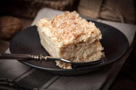 Homemade cake with ground walnut and coconut. Dark Light. Stock Photo