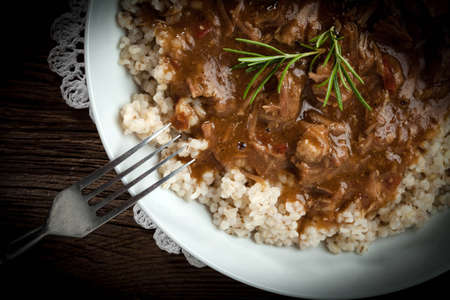 Tasty meal - cooked barley porridge and stew of pork. Stock Photo