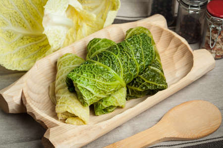 Cabbage rolls stuffed with meat and grits prepared for cooking. Stock Photo