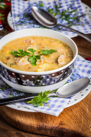 Traditional soup with barley and chicken gizzards. Stock Photo