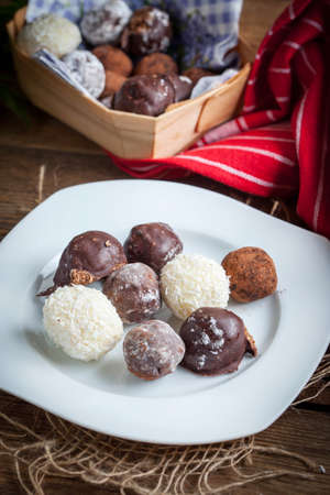 Homemade sweet balls on a wooden table. Selective focus. Stock Photo