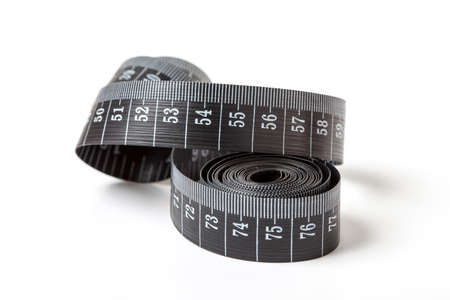 Black tape measuring isolated on a white background. Stock Photo