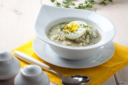 sorrel: Homemade sorrel soup with egg and rice in a bowl. Stock Photo