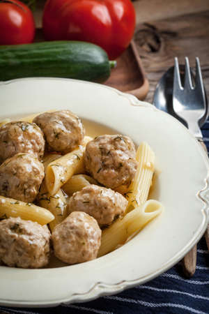 meaty: Pork meatballs with dill sauce and pasta. Selective focus.