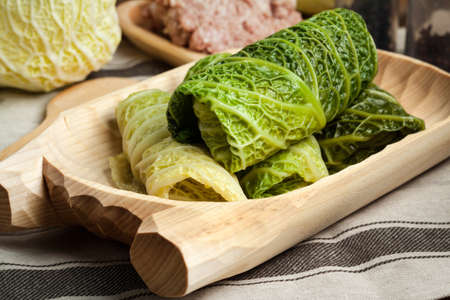 stuffing: Cabbage rolls stuffed with meat and grits prepared for cooking. Stock Photo