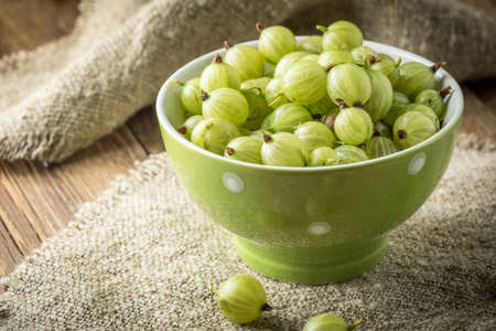 Fresh gooseberry in bowl. Small depth of field.