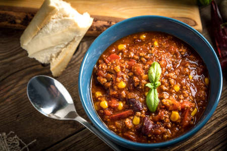 Mexican chili con carne in bowl. Selective focus.