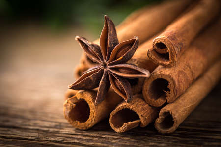 anis: Anise stars and cinnamon on wodden table. Stock Photo