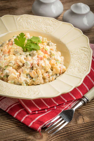 Traditional salad with cooked vegetables with mayonnaise.