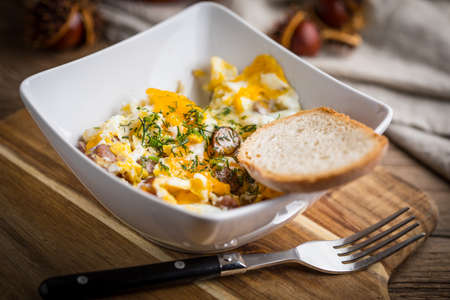 Tasty breakfast - scrambled eggs with sausage and bread. Stock fotó