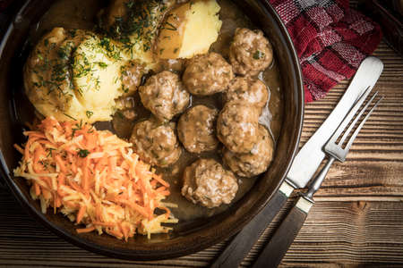 Swedish meatballs in dill sauce served with mashed potatoes and carrot salad. Stock fotó