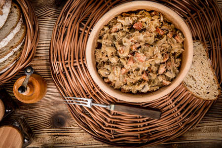 Bigos - stewed cabbage with meat,dried mushrooms and smoked sausage. Traditional dish of polish cuisine. Top view. Stock fotó