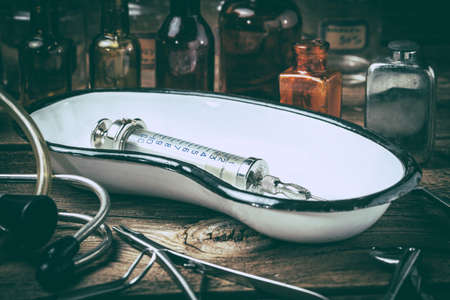 Retro medical tools on a wooden table. Selective focus. Filtered style. Stock Photo