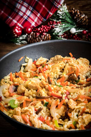 Fried rice with chicken served in a wok. Chinese cuisine.
