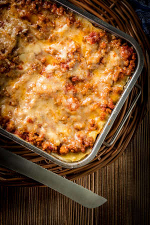Homemade lasagne bolognese in metal baking form. Top view. Standard-Bild