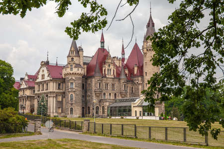 MOSZNA, POLAND - JUNE 27, 2015 ; Moszna Castle built in XVII century is one of the best known monuments in Upper Silesia. Editorial