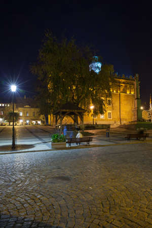 SANDOMIERZ, SWIETOKRZYSKIE PROVINCE  POLAND, OCTOBER 05, 2015: Brick gothic town hall and octagonal renaissance high clock tower on Old Market square.