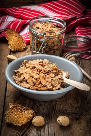 Healthy breakfast - bowl of cereals on a wooden table. Stock Photo