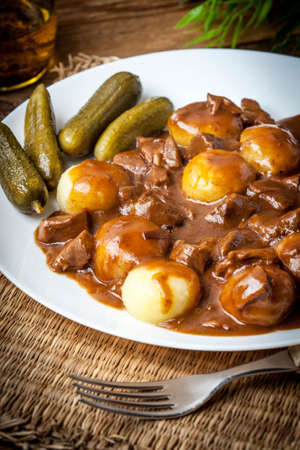 Stew served with silesian noodles and sauce. Selective focus. Banque d'images