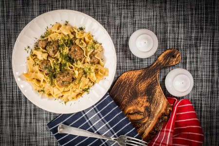 Tagliatelle pasta with pork meatballs and dill sauce. Top view. Reklamní fotografie