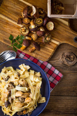 Tagliatelle pasta with forest mushrooms and chicken. Small depth of field.