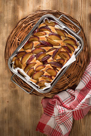 Plum cake, traditional homemade cake with fruit. Delicious fruit cake.
