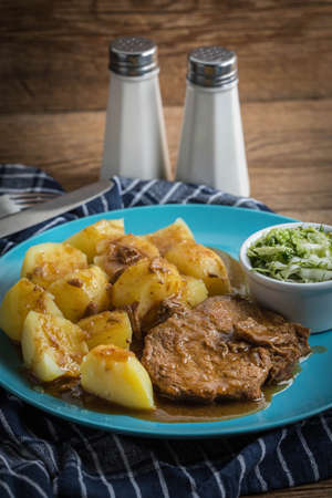 Braised meat in sauce served with boiled potatoes. Selective focus. Stockfoto