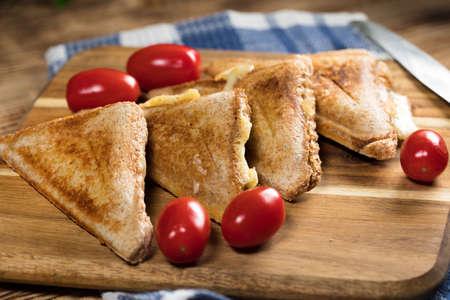 Grilled cheese sandwich on plate. Shallow depth of field. Reklamní fotografie - 133484292