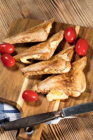 Grilled cheese sandwich on plate. Shallow depth of field. Reklamní fotografie - 133484296
