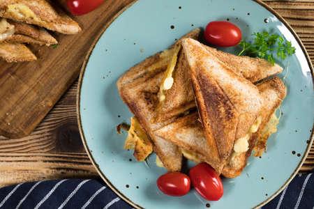 Grilled cheese sandwich on plate. Shallow depth of field. Reklamní fotografie - 133484300