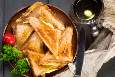 Grilled cheese sandwich on plate. Shallow depth of field. Top view.