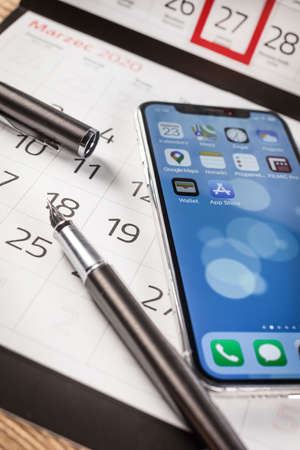 KATOWICE, POLAND - February 23, 2020 : smartphone iPhone XS from Apple and calendar on 2020 year. Publikacyjne