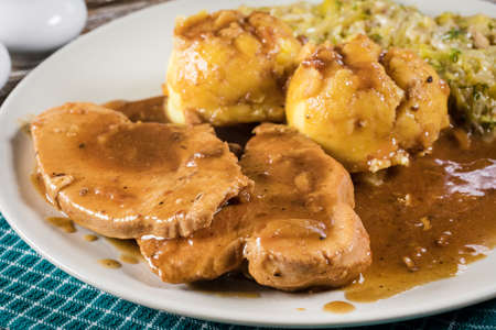 Stewed turkey meat in gravy. Selective focus. Stock Photo