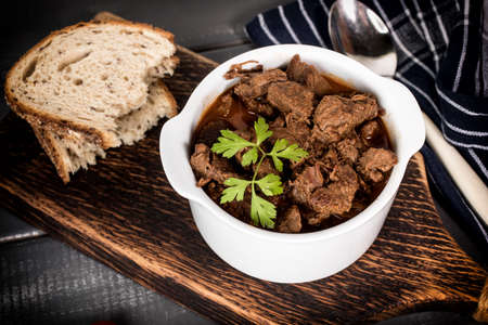 Beef meat stew in ceramic pot. Selective focus.