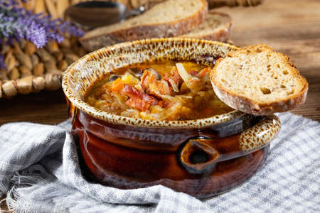 Traditional russian sour cabbage soup on wooden table. Selective focus. Stock Photo