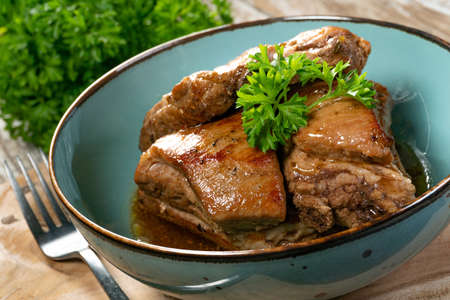 Braised pork spare ribs served in bowl.