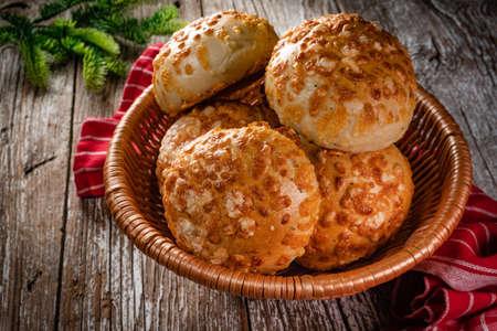 Fresh breakfast rolls with cheese in a wicker basket.
